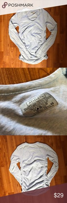 Athleta Long Sleeve Shirt NWOT My fiancée never wore! (In the air force now) she just stuck in her dresser and the material makes it look wrinkled! Very $$ shirt! Athleta Tops Tees - Long Sleeve