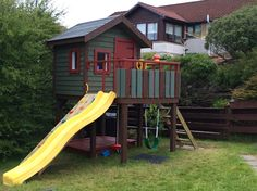Our Wind proof playhouse on stilts with slide, climbing wall sandpit and swings