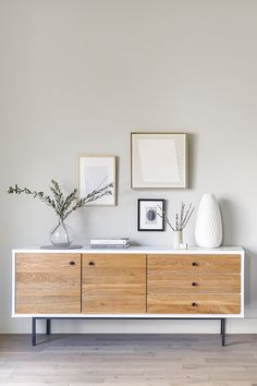 The Bios sideboard is a combo of wild solid oak and smooth, high-gloss lacquer. This handsome white sideboard with powder-coated metal legs boasts ample storage space: its cupboards are hidden behind soft close drawers and doors. Two ends of the design spectrum, beautiful together. #SmallSpaceStorage #SmallSpaceLiving