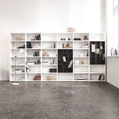 Wall system: Bo-Concept - Wall to wall shelving with compartments will give plenty of welcome shelf space. Wall system, white lacquered/charcoal grey lacquered, £4,295, study floor lamp, £279, Bo-Concept (boconcept.com)