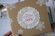 such a pretty DIY Christmas gift wrap idea using brown paper and a doily/doilies