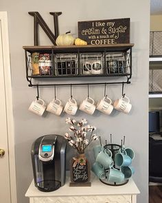coffee bar/station Love that shelf with baskets and hooks, but I might snip off a few hooks and spray it with some matte clear coat to use in the toilet closet.