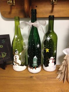 Snowmen painted on wine bottles