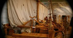 A vikings pier replica located in the Vikingeskibsmuseet Roskilde, Denmark  with one boat tied.