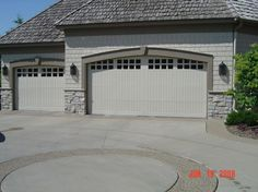 grey stone houses with white garage door | Door for Tasteful You : Black Wall Lamps White Stony Wall Garage Door ...