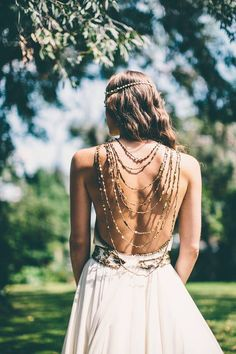 Stunning back detail on this boho bride's dress