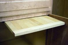 """EZ Slide N Store Wood Breadboards by Rockler. $47.25. Utilize unused kitchen space with this convenient cutting board setup! The durable hardwood board stows neatly in the open space of almost any base cabinet. Simply slide it out, use it on your counter, then tuck it back in completely out of the way! Includes two steel storage rails and all mounting hardware for fast, easy installation. Board measures 16"""" x 22"""" x 3/4"""".  * Finger grooves makes cutting board easy to p..."""