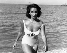 Liz and the pure glamour of a white swimsuit