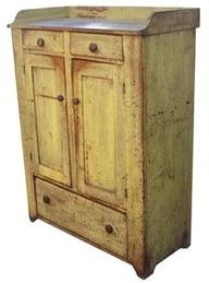 century, Pennsylvania Jelly Cupboard, very unusual form with . Two drawers over door doors oversized drawer in the bottom , applied dovetaile gallery. Retains old, worn yellow paint over original red. Primitive Painted Furniture, Primitive Cabinets, Old Cabinets, Country Furniture, Antique Furniture, Furniture Logo, Kids Furniture, Rustic Cabinets, Wooden Cabinets