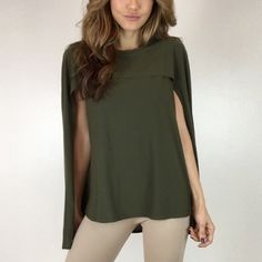 "Olive Cape Top S M L The perfect alternative to a blouse. A sophisticated & unique top in a stretchy comfy fabric. Size M measures 18"" across the chest and measures 24"" in length. 96% Poly 4% Spandex. Runs on smaller side. For size reference I am wearing Size S- 5'3""-105lbs -Sz 0/2 * Please do not purchase this listing- Thank you! * Price Firm * Boutique Tops"