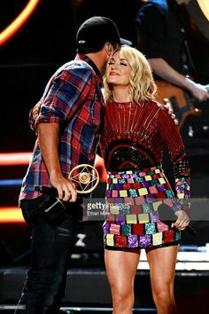 Carrie Underwood and Luke Bryan at the 2016 American County Countdown Awards