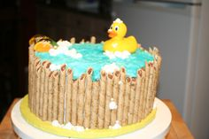 Rubber Ducky Baby Shower cake - I made this for a triple baby shower I attended. It was both genders so this was very neutral. I got my idea from other cc people, so thank you all very much! I did my own take on it with the baby soap. It was a huge hit!