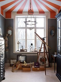 circus...one of my favorite ceiling treatments for a kid's room.  Love the modern color scheme here- so unexpected.  It lends a real sense of sophistication to this theme!