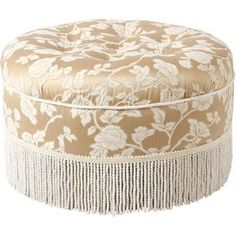 """Offer guests an extra seat or rest a tray of drinks on this chic design, artfully crafted for lasting appeal.    Product: OttomanConstruction Material:  Polyester and cottonColor: ChampagneDimensions: 14"""" H x 24"""" Diameter"""