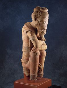 The earliest known figurative sculpture from sub-Saharan Africa was made by the Nok People of Eastern Nigeria starting around 500 BCE. The figures are large and many were complete figures in standing, sitting or genuflecting positions. A salient feature is the head which s proportionately larger than the body. Seated Dignitary, ca. 250 BCE. Fired Clay; H. 36 1/4 x W. 10 7/8 x D.14 in. The Minneapolis Institute of Arts