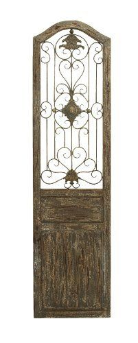 "Garden Style Wooden Door With Scrolling Ironwork by Benzara. $67.10. Important Features: _Made of wood and metal _Size: 19""x1""x72"" This door is made with a unique garden gate styled floral center and scrolling ironwork that meanders out from it. The plaque is made into the shape of an old fairy tale style door, adding a beautiful and rustic quality anywhere you hang it. Ideally hung in a beautiful backyard garden or patio for a fairy tale escape.. Save 39%!"