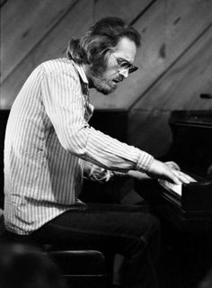 Bill Evans. I can't think of anyone more able to move me with his/her piano. A drink in Paris with Bill.