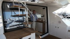 Beneteau Gran Turismo 49: You've got to love how wide this opening is. And notice the lower sill that ensures that rain water on the cockpit stays outside where it belongs. The optional entertainment center can be seen under the stairs.