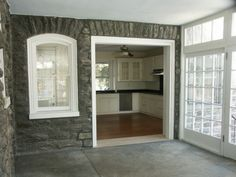 perhaps in stead of opening the entire wall make window an open shelf? breezeway / enclosed porch
