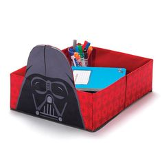 "Avon Living Star Wars Darth Vader™ Under the Bed Storage | AVON | Neat tip! Stash toys, supplies, shoes or clothes and slide under the bed.  FEATURES • A rectangle shaped storage box without a lid featuring Darth Vader™ on front exterior • Image of Darth Vader™ acts as a handle when pulling unit out from under the bed • It is great for stashing toys, supplies, shoes or clothes • Just slide it under the bed when tidying up the room • 17"" L x  13"" W x 5"" H  MATERIALS • 100% Polyester  CARE…"