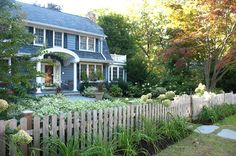 Gives a feeling of privacy without boxing you in too much-  Less Lawn More Garden traditional landscape