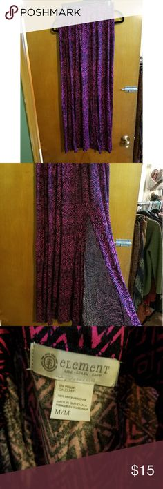 Black and pink long skirt Long skirt with skit up thigh. Elastic around the waist. Thin material. Lightly worn. Element Skirts