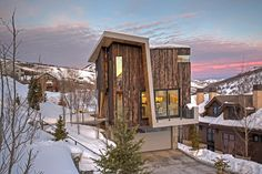 Clad in shou sugi ban cedar with a sculptural roof that cuts through the home, this property in Park City, Utah, also features passive solar design and smart home technology.