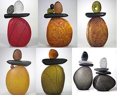 """Cairn rock totems. These blown glass cairns are individually formed then fused together & etched to create the stone-like finish. 10.5"""" H, 6"""" W, 4"""" D."""