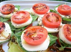 Caprese Salad:  fresh basil leaves, fresh tomatoes, and fresh (soft) mozzarella cheese. [I would use a cheese substitute because I'm vegan] Slice the tomatoes and cheese and stack (tomatoes first, cheese on top) with one or two basil leaves. Arrange like patties on a plate (3 or 4 per person) and sprinkle with a little olive oil, balsamic vinegar, salt and pepper.