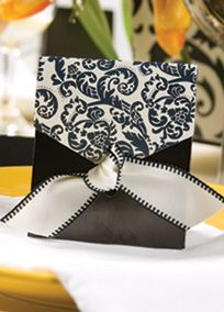 Elegant favors begin with beautiful boxes! These black boxes have ivory flaps printed with a black damask pattern. Pre-cut ivory ribbon with black stitching is included for tying the boxes closed. Style DBK22054 at David's Bridal.