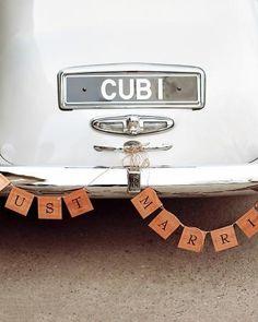 A Rolls Royce with Just Married Banner - Martha Stewart Weddings
