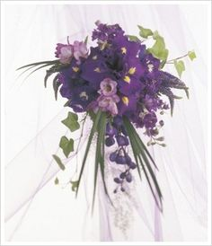 Purple iris, veronica, ivy leaves and purple tulips in this lovely bouquet...one of my top 5 fav's so far.