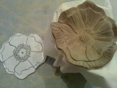 Making a porcelain poppy.