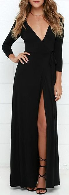 Lightweight jersey knit forms this three-quarter sleeve stunner with a wrapping surplice bodice, and tying sash at the waist. Wrapped detail carries into a front slit maxi skirt for a sensational finish.