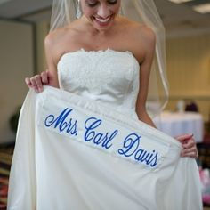 "This bride surprised her husband with her married name sewn underneath her dress as her ""something blue."""
