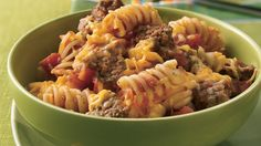 Ground beef, pasta and tomatoes come together to create a flavorful casserole. Classic cuisine!
