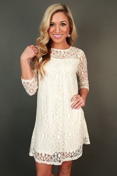 Go to a viewing in style, and be viewed in style, in this lace shift dress!