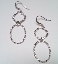 Link earrings, a combo of  textured oval and diamond shaped links. http://silverelementscollection.com/collection/link-earrings
