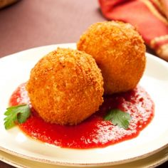 Pizza Rice Balls - I would use regular brown rice, but maybe I could sneak some veggies into my kids?!