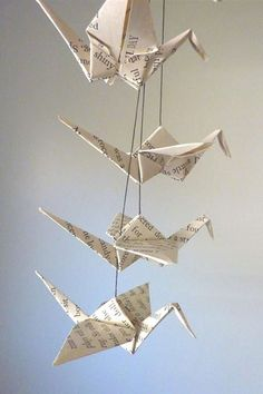 Forget about flowers — instead, carry one of these beautiful origami crane mobiles from Spare Bedroom Studio.