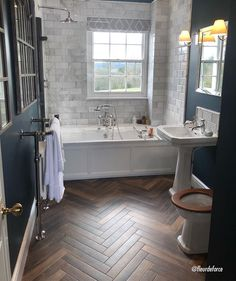 Discover high-quality wood effect tiles for floors in our extensive range. Stylish and durable, these wood effect tiles will stand the test of time. Wood Tile Bathroom Floor, Wood Tile Floors, Brick Flooring, Penny Flooring, Tiled Bathrooms, Garage Flooring, Linoleum Flooring, Grey Flooring, Flooring Ideas