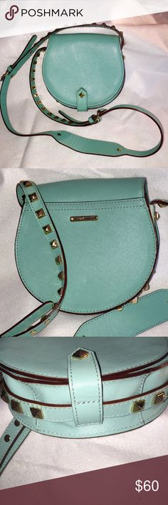 """⚠️SALE⚠️ Rebecca Minkoff Shoulder Bag Gently used, this sweet bag has adjustable shoulder strap and signature Minkoff guitar strap detailing with square studs. Exterior in great shape with minute soiling, but a little schmutz (ink?) on the label inside. Caution: this bag does NOT hold an iPhone 6 Plus which is why I'm parting with it. Measures 7"""" at widest part, 6 1/2"""" tall and 2"""" deep. Rebecca Minkoff Bags Shoulder Bags"""