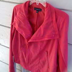 Rock & Republic Moto Jacket This jacket by Rock & Republic has side panels and two front pockets. The outside fabric is suede-like polyester in the Hibiscus color, which is a coral pink shade. Size 16, large. In excellent, like new condition! Rock & Republic Jackets & Coats