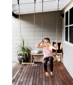 Swings on front porch. Great idea, kids can get out and play even when it's raining.