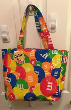 M M Candy Vinyl Shopper Tote Bag Purse Rainbow Colors Mars Candy Company, Shopper Tote, Tote Bag, M&m Characters, M M Candy, Frozen Lemonade, Candy Companies, Pepsi, Peanuts