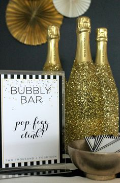#Bottles that look dipped in #gold dust add dazzle to your #bar. Find out how to make these yourself. #DIY #EviteGatherings #NYE