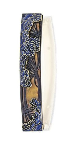 Lalique c1900. Horn and Enamel Barrette. Black, brown and honey-colored carved horn, accented by blue enamel in a foliate pattern. Signed. | Sotheby's
