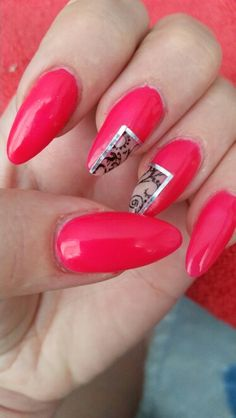 Almond shaped acrylics with neon pink gel polish and stamping