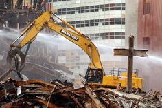 Dec. 2, 2001    A steel cross stands among the twisted beams in the debris field of what once was 5 World Trade Center as cleanup and recovery efforts continued.  Louis Lanzano / AP