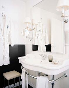 black and white bath.  chrome base sink + sconces + swing arm mirror   michelle bonan
